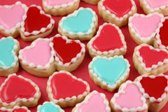 Hearts. Heart cookies on a red background stock images