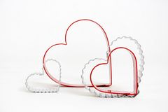 Hearts. Heart cookie cutters with white background royalty free stock images