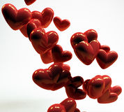 Hearts. Three-dimensional red hearts floating in midair Royalty Free Stock Images