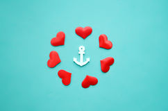 Hearts and anchor on a blue background royalty free stock photos