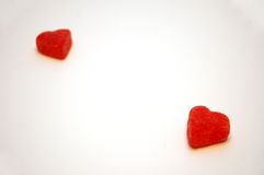 Hearts Apart Valentines Day Candy. A pair of red jelly candy Valentines Day Hearts, separated from each other royalty free stock photography