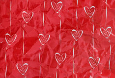 Hearts and arrows. Ten hearts and arrows on creased red paper Royalty Free Stock Photos