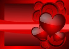 Hearts on background in red tones. Image representing three red hearts on a fantsy background Stock Images