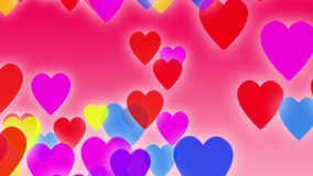 Hearts background animation. Colorful hearts slowly falling down on a pink background with particles flowing around.  stock footage