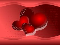 Hearts on background in red tones. Image representing three red hearts on a fantsy background Royalty Free Stock Images