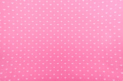 Hearts Background Pattern. White printed hearts set against a pink background Royalty Free Stock Image