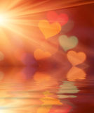 Hearts background. Wallpaper of blurred lights and reflection Royalty Free Stock Image