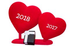 Hearts And Black Gift Box On White Background, New Year Concept. 2017, 2018 new year concept. Red soft hearts and a black giftbox with white ribbon isolated on Stock Images