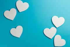 Hearts on blue background. Copy space. Top view royalty free stock image