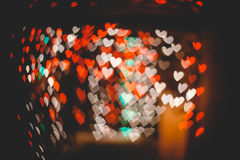 Hearts bokeh in dark texture for use in graphic design. Valentines style defocused lights background. St. Valentine`s Day Royalty Free Stock Image