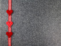 Hearts with border on stone. Red hearts with border on stone Royalty Free Stock Images