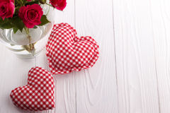 Hearts and a bouquet of pink roses in a vase Royalty Free Stock Photo
