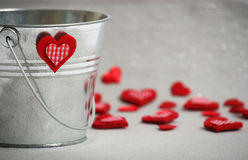 Hearts in a Bucket. Valentine Hearts slop out of bucket Stock Photos