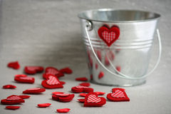 Hearts in a Bucket. Valentine Hearts slop out of bucket Stock Images