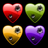 Hearts with bullet holes Royalty Free Stock Photos