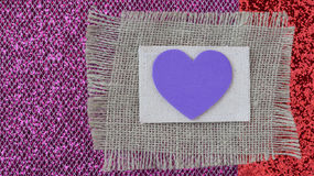 Hearts with Burlap on Pink Wood Background Stock Image