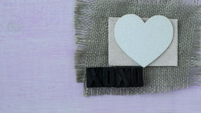 Hearts with Burlap on Pink Wood Background Stock Images