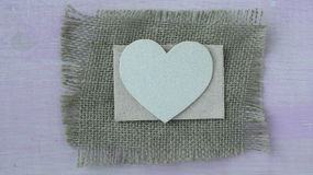 Hearts with Burlap on Pink Wood Background Stock Photos