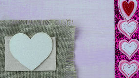 Hearts with Burlap on Pink Wood Background Royalty Free Stock Images