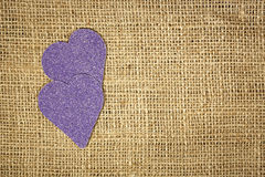 Hearts on burlap Stock Images