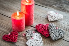 Hearts with burning candles on the wooden background Royalty Free Stock Image
