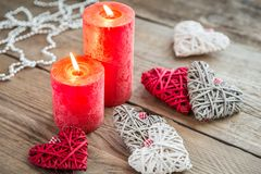 Hearts with burning candles on the wooden background Royalty Free Stock Photography