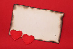 Hearts and burnt blank paper Stock Photography