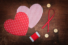 Hearts and buttons on old shabby wooden background Stock Images