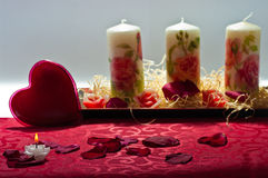Hearts, candles and rose petals. Heart candle and rose petals Royalty Free Stock Photography