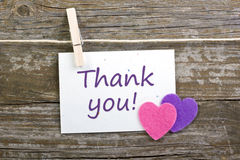 Thanks. Hearts, card with lettering thanks and close spins on wooden ground stock images