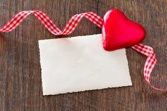 Hearts card ribbon dark wood Stock Photography