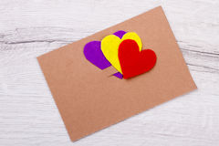 Hearts and card on wood. Royalty Free Stock Images