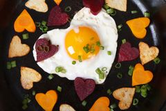 Hearts of carrots, potatoes, beets and eggs Royalty Free Stock Photography