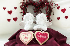 Hearts and cherubs. Cherubs and wreath with be mine ceremic hearts that say Be mine Stock Image
