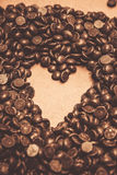 Hearts and chocolate drops. Valentines background Royalty Free Stock Images