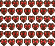 Hearts chocolate pattern with red bow on white Royalty Free Stock Image
