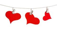 Hearts on a clothesline Stock Photo