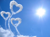 Hearts and clouds Stock Photos