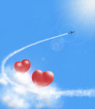 Hearts in clouds and airplan Stock Photos