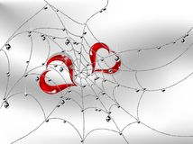 Hearts in cobweb Royalty Free Stock Photo