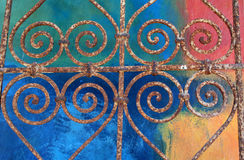 Hearts and Color. Wrought iron grate against multi-colored wall stock photos
