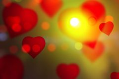 Hearts Color Bokeh on abstract red Royalty Free Stock Photo