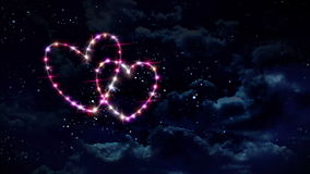 Hearts color star at night. Starry night in space background with heart forming from stars stock video footage
