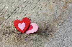 Hearts on a wood. Hearts of color on a wood Royalty Free Stock Photos