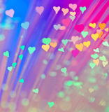 Colorful hearts. Lots of small hearts on a blurred colorful background Royalty Free Stock Photography
