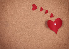 Hearts on corkboard Stock Photos