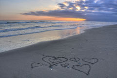 Hearts on Costa del Sol beach. Hearts scratched in the sand on Costa del Sol beach stock photos