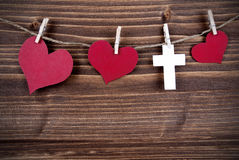 Hearts and a Cross on a Line Royalty Free Stock Photos