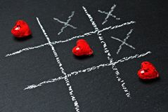Hearts and crosses Royalty Free Stock Images