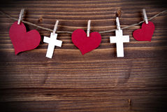 Hearts and Crosses on a Line Royalty Free Stock Photos